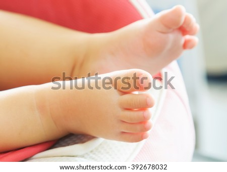 Baby feet newborn, feet of little baby newborn - stock photo