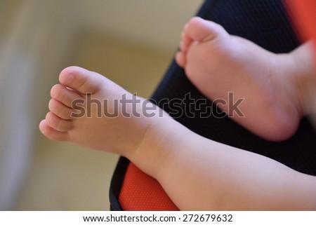 Baby feet. Selective Focus - stock photo
