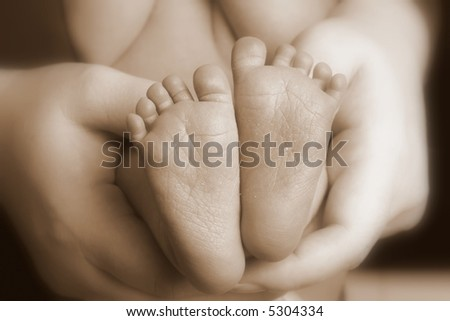 Baby Feet, Sepia Toned - stock photo