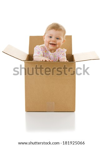 Baby: Female Baby Playing Inside Cardboard Box - stock photo