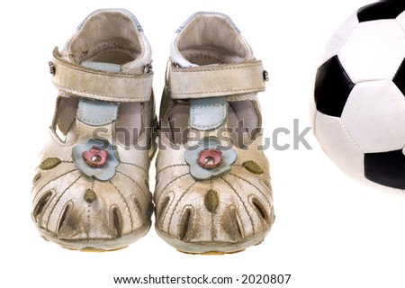 Baby football shoes and ball on white background - stock photo
