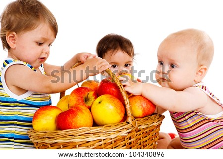 Baby friends with apples basket - stock photo