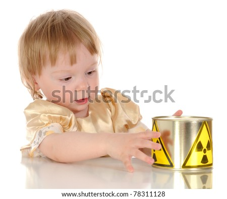 Baby girl and radioactive canned on white background - stock photo