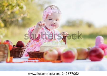 Baby girl celebrating her first bithday - stock photo
