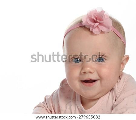 baby girl child  smiling happy pink fashion portrait face studio shot isolated on white caucasian - stock photo