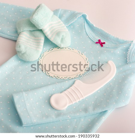 Baby girl colorful clothes with add card - stock photo