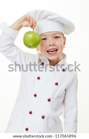 Baby girl cook with green apple
