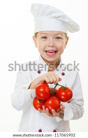 Baby girl cook with tomatoes