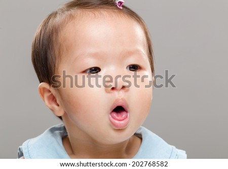 Baby girl coughing - stock photo