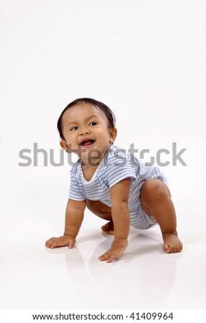 Baby girl crawling on white background, she looks cute - stock photo
