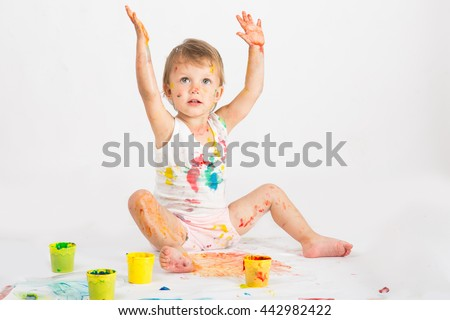 baby girl draws a finger paints - stock photo