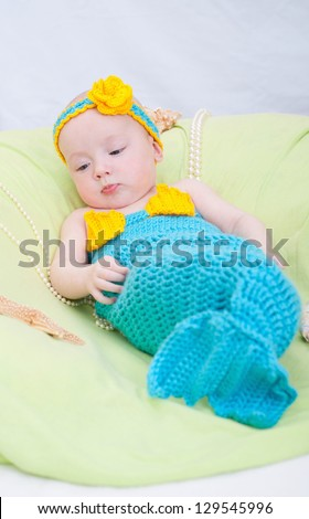 Baby girl dressed as a mermaid - stock photo