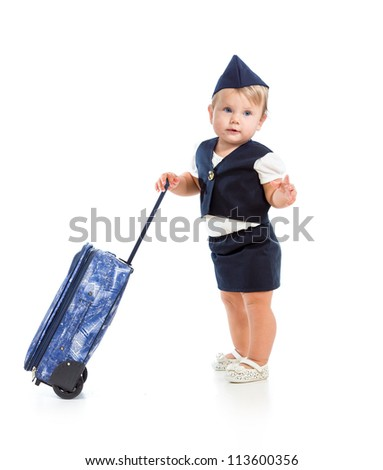 baby girl dressed as  stewardess with trunk - stock photo