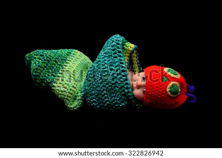 Baby girl dressed as the hungry caterpillar - stock photo