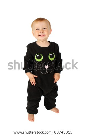 Baby girl dressed in a Halloween cat costume on white background - stock photo
