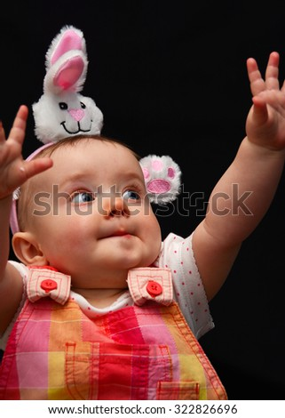 Baby girl dressed in Easter clothes - stock photo