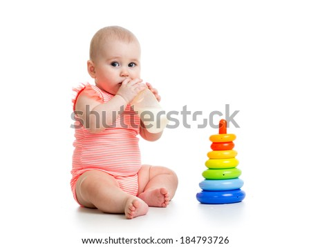 baby girl drinking milk from bottle - stock photo
