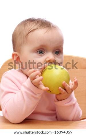 Baby girl eating an apple - stock photo