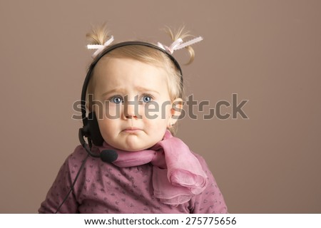 Baby girl getting sad news by phone - stock photo
