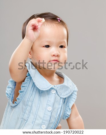 Baby girl hand up - stock photo