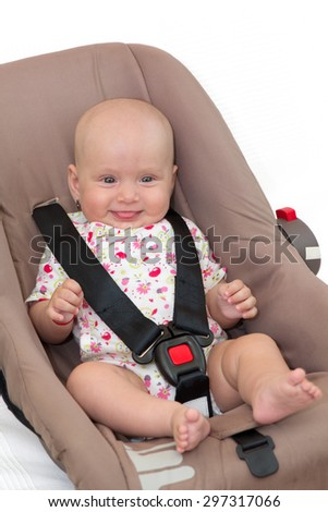 Baby girl in a car seat, isolated - stock photo