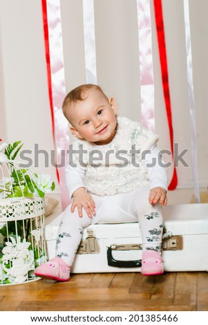 Baby girl in a fashionable suit smilling - stock photo