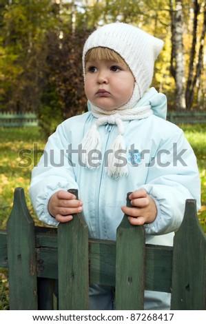 Baby girl in autumn park - stock photo