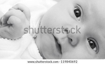 Baby girl - in black and white - stock photo