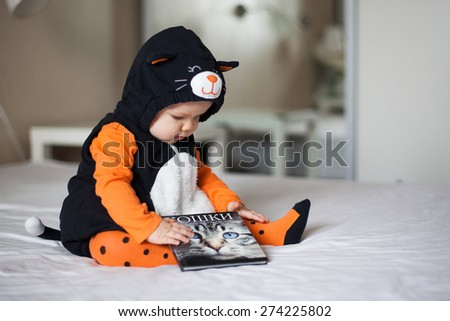 Baby girl in cat costume - stock photo