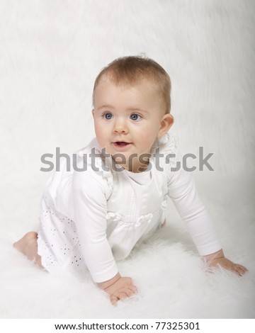 baby girl in christening gown - stock photo