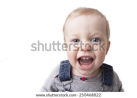Baby girl in overalls wide angle close up isolated on white - stock photo