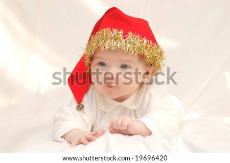 Baby girl in red hat - stock photo