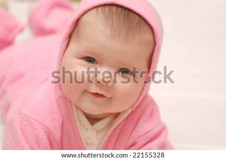 Baby girl in rose hood - stock photo