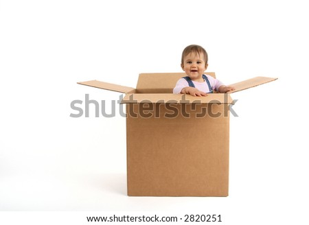 baby girl inside box, laughing - stock photo