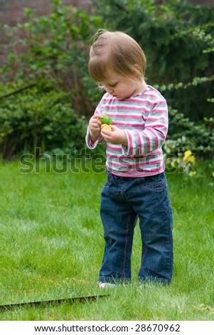 Baby-girl is exploring her chocolate candy - stock photo