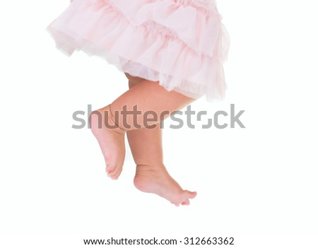 baby girl like a ballet dancer in pink tutu, isolated on white background