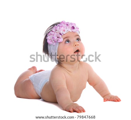 Baby Girl lying down and looking up, isolated on white - stock photo