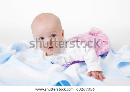 baby girl lying on a white background