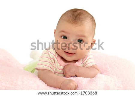 Baby girl on pink blanket.