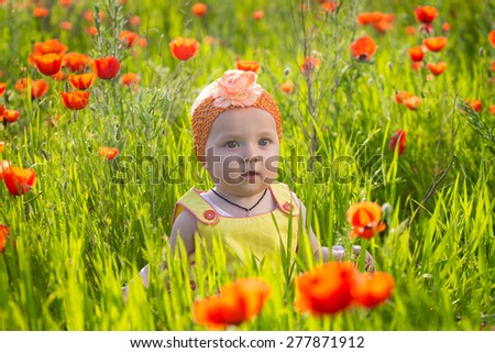 Baby girl on the flower filed - stock photo