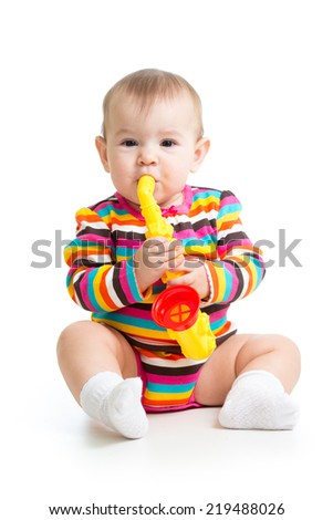 baby girl playing with musical toy - stock photo