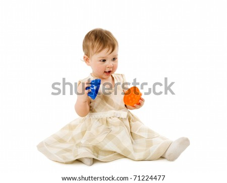 Baby girl playing with toy wearing pink dress isolated - stock photo