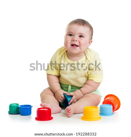 baby girl playing with toys isolated on white - stock photo