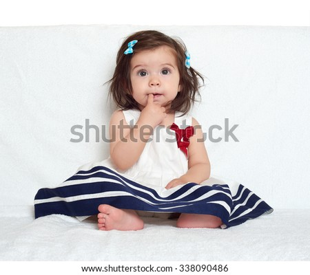 baby girl portrait, sit on white towel - stock photo
