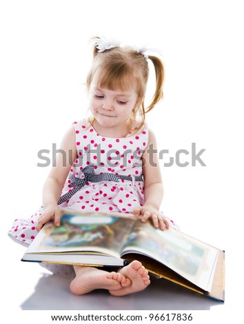 baby girl reading a book. isolated on white background - stock photo