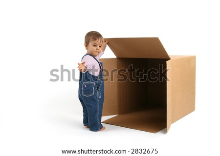 baby girl releasing ideas outside the box - stock photo