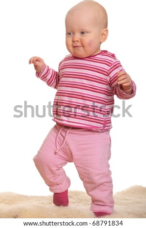 Baby girl's first steps - stock photo