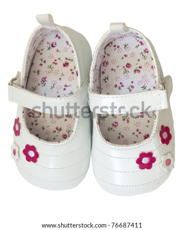 baby girl's shoes isolated - stock photo