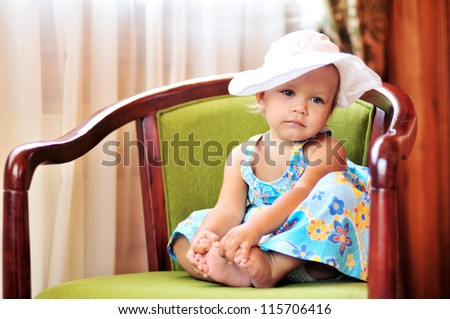 baby girl sitting on the chair - stock photo