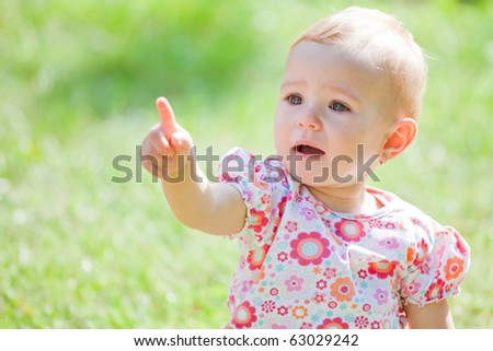 Baby girl spending time outdoor on a summer day. - stock photo